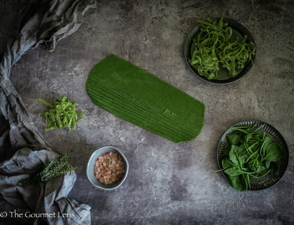 Flatlay of rolled out homemade spinach pasta